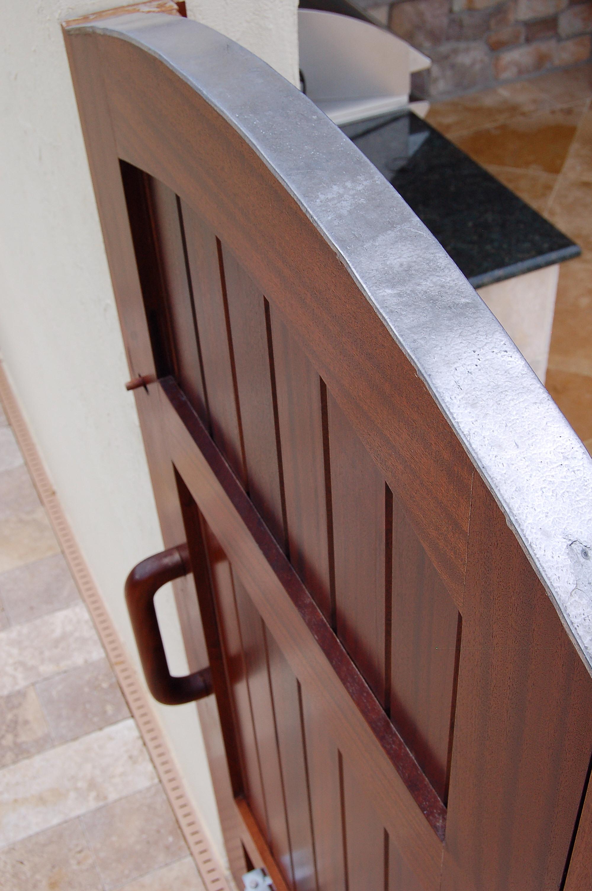 Exterior arched top mahogany door