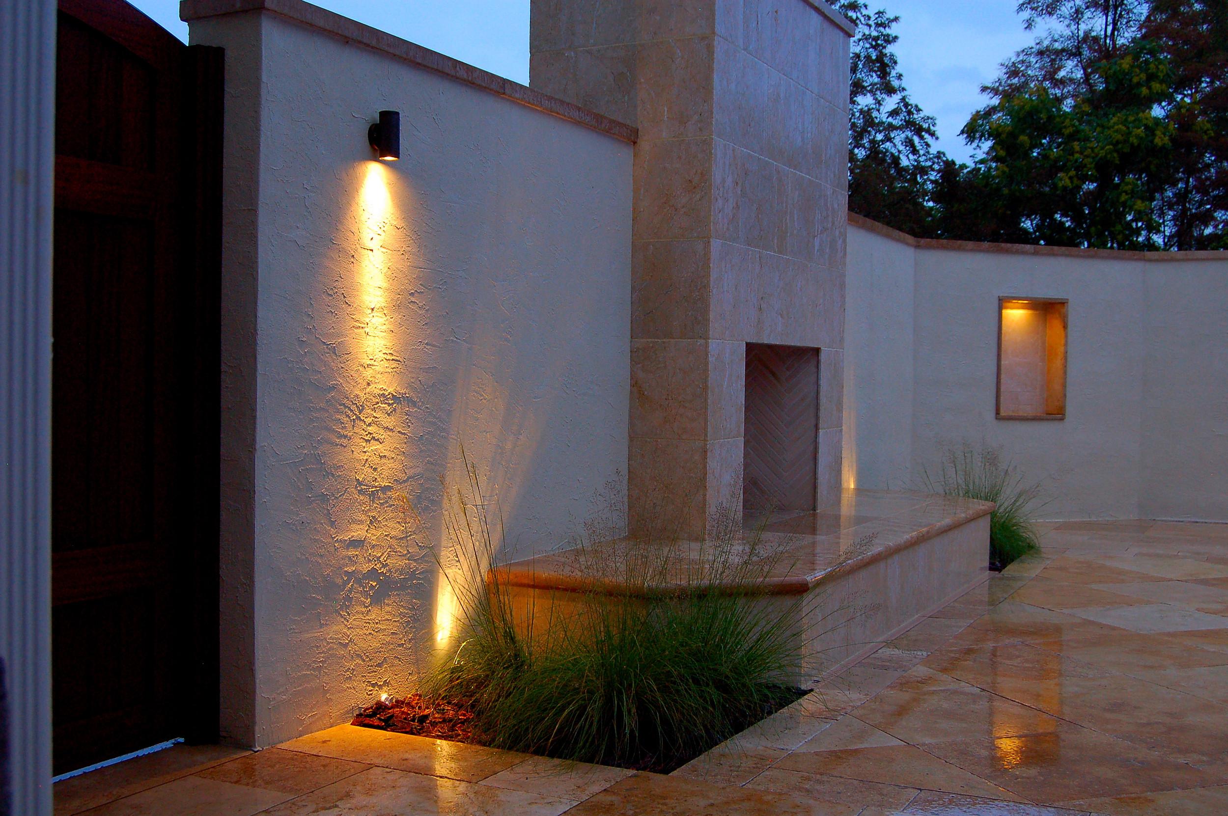 Mediterranean style travertine outdoor fireplace