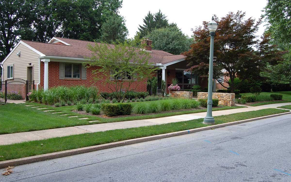 Traditional Pennsylvania brick home landscape design