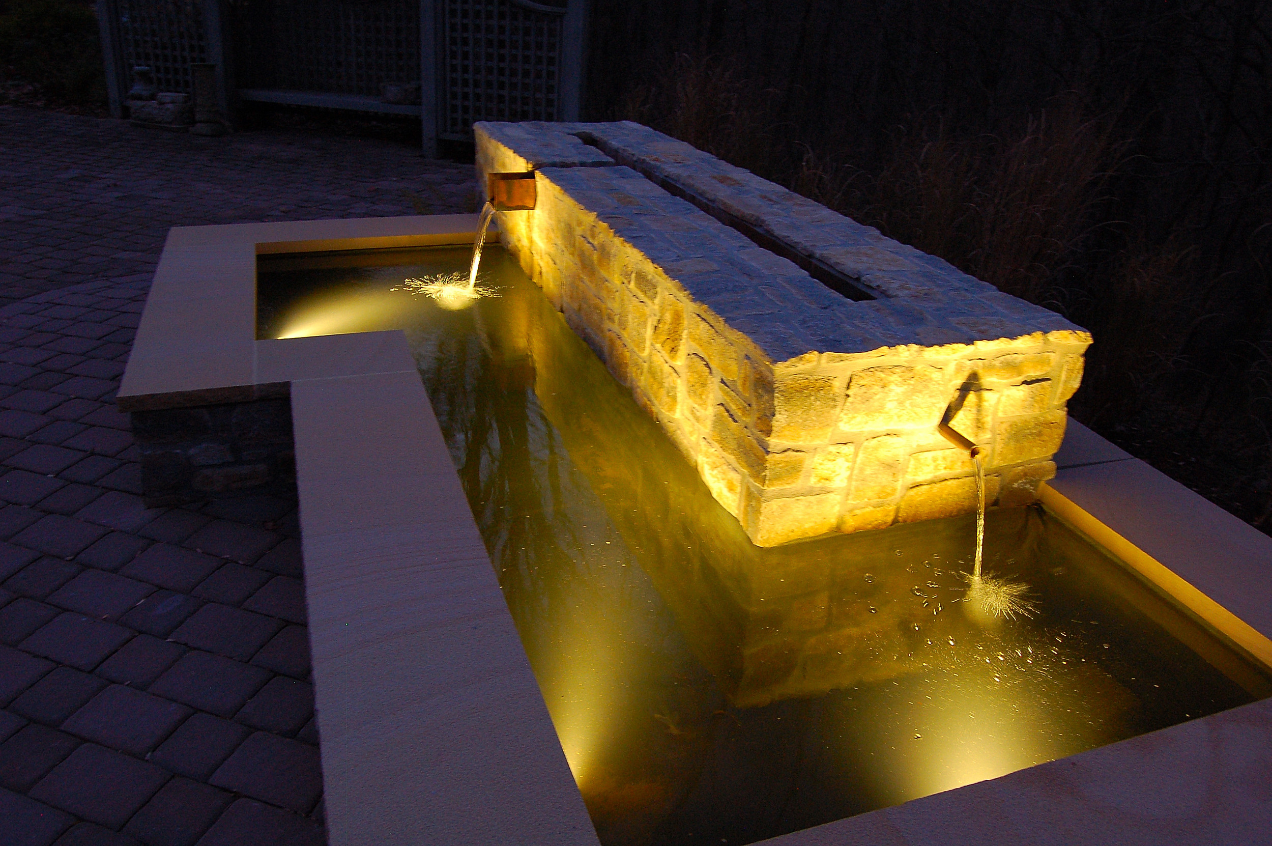 Lighted stone water feature at night