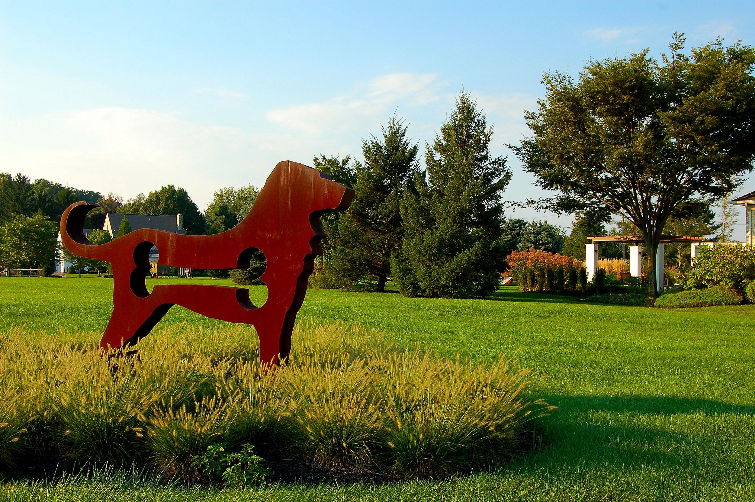 Cor-Ten steel dog sculpture by artist Dale Rogers