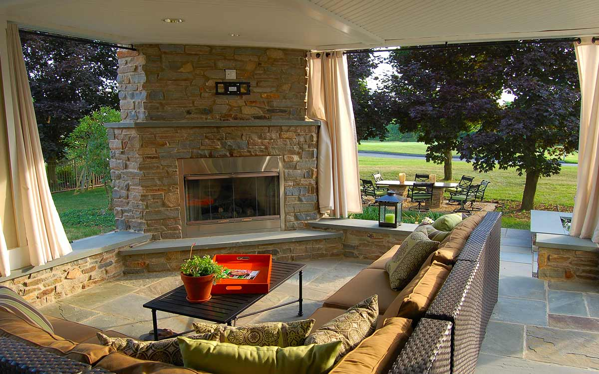 Outdoor fireplace architecture and seating area