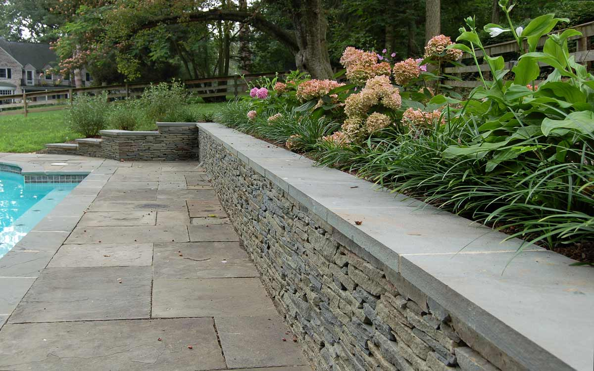 Dry stack fieldstone retaining wall