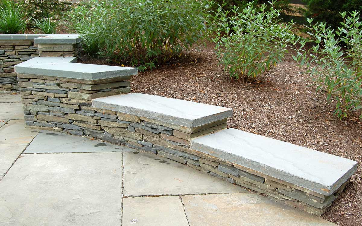 Fieldstone retaining wall with bluestone cap