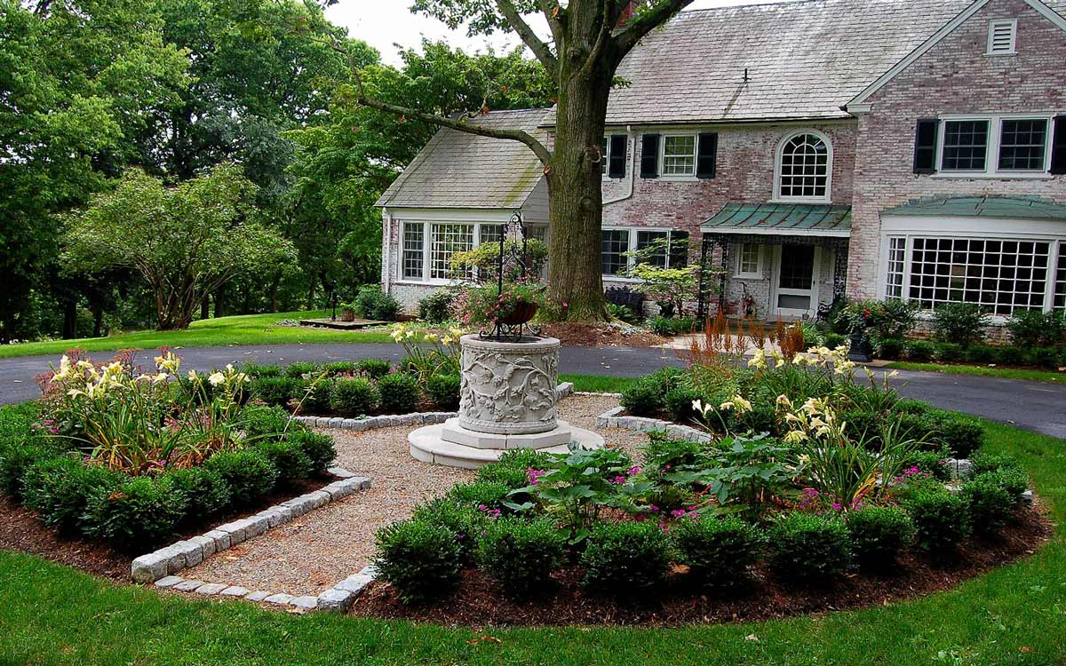 Traditional landscape design with wellhead