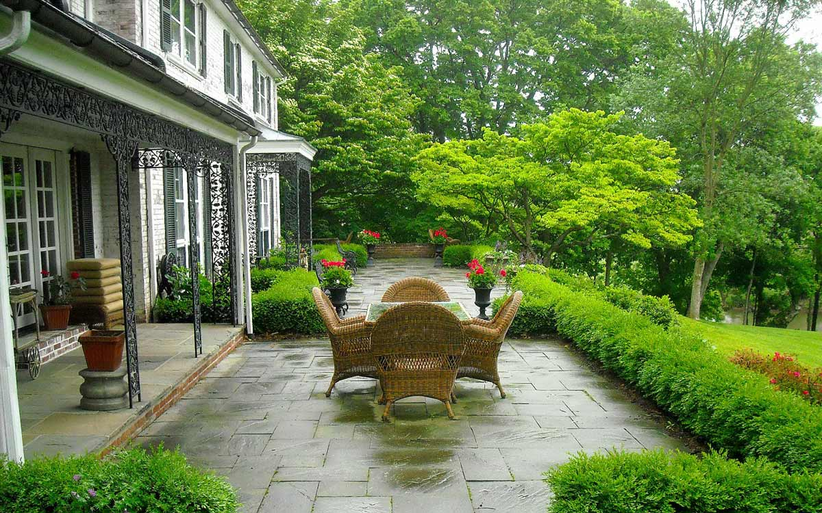 A landscape design with seating area off the entrance