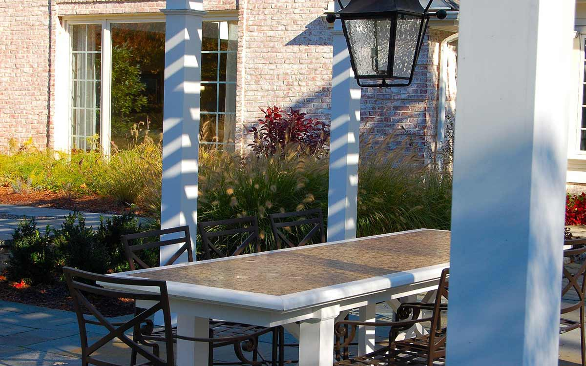 Custom outdoor dining table and pergola