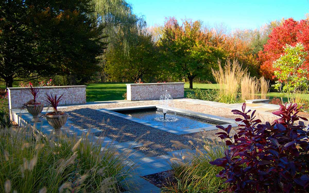 Fountain, brick walls, pea stone and cleft fieldstone