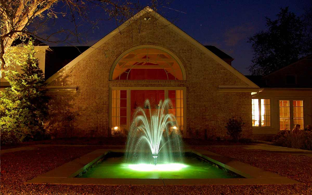 Landscape design with fountain as seen at night