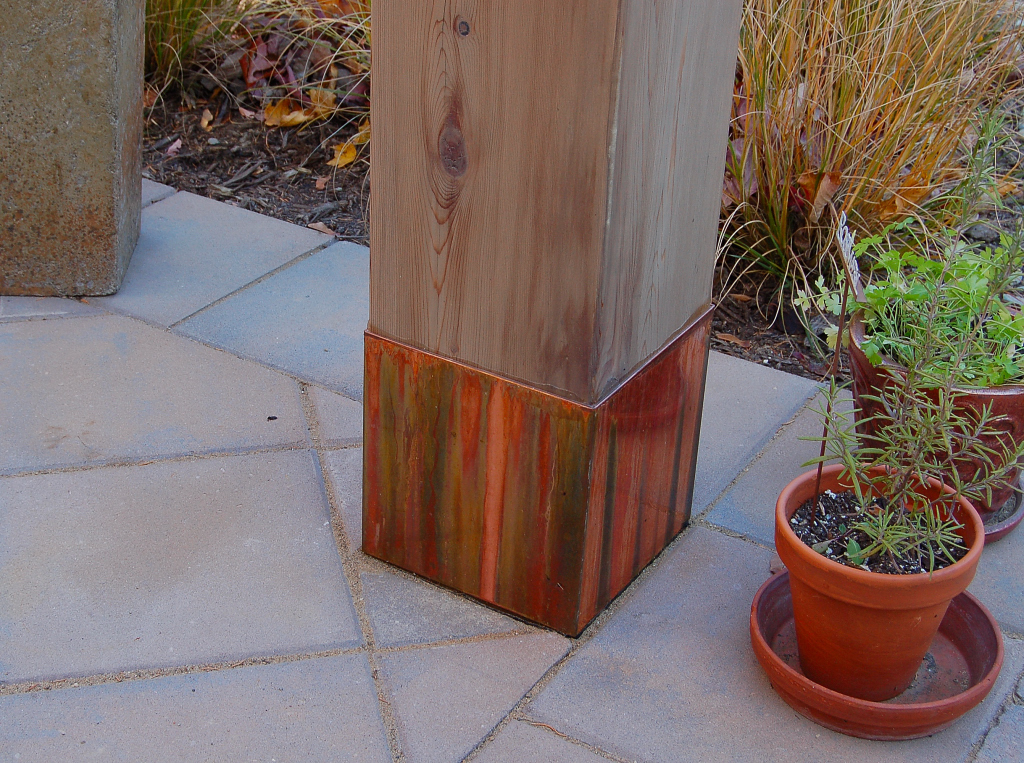Copper accents the pergola footings