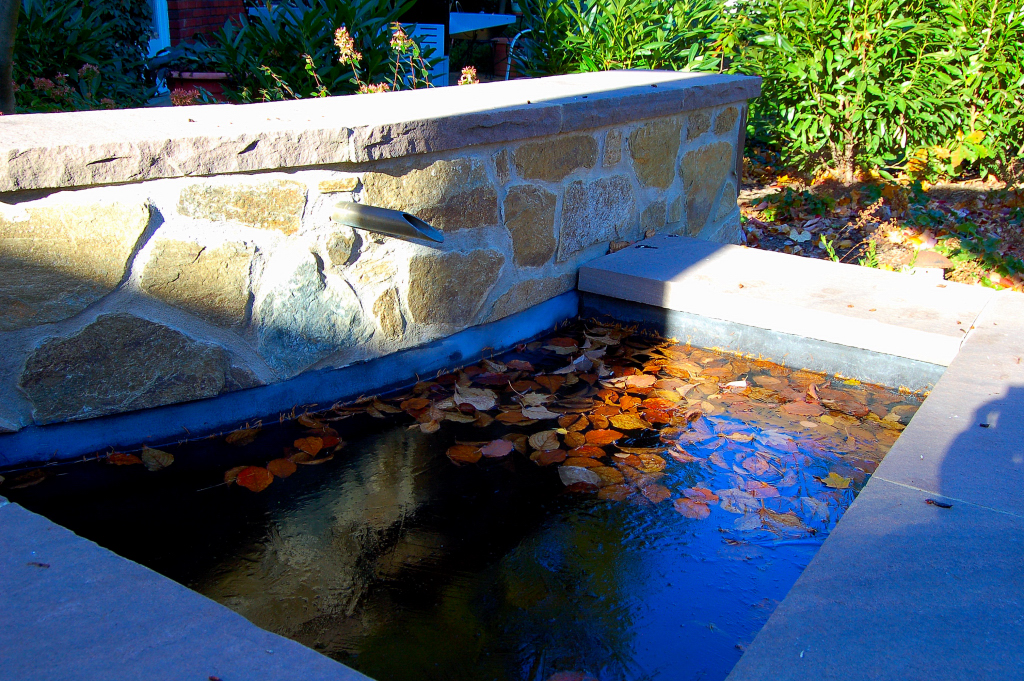 Stone walls and water feature