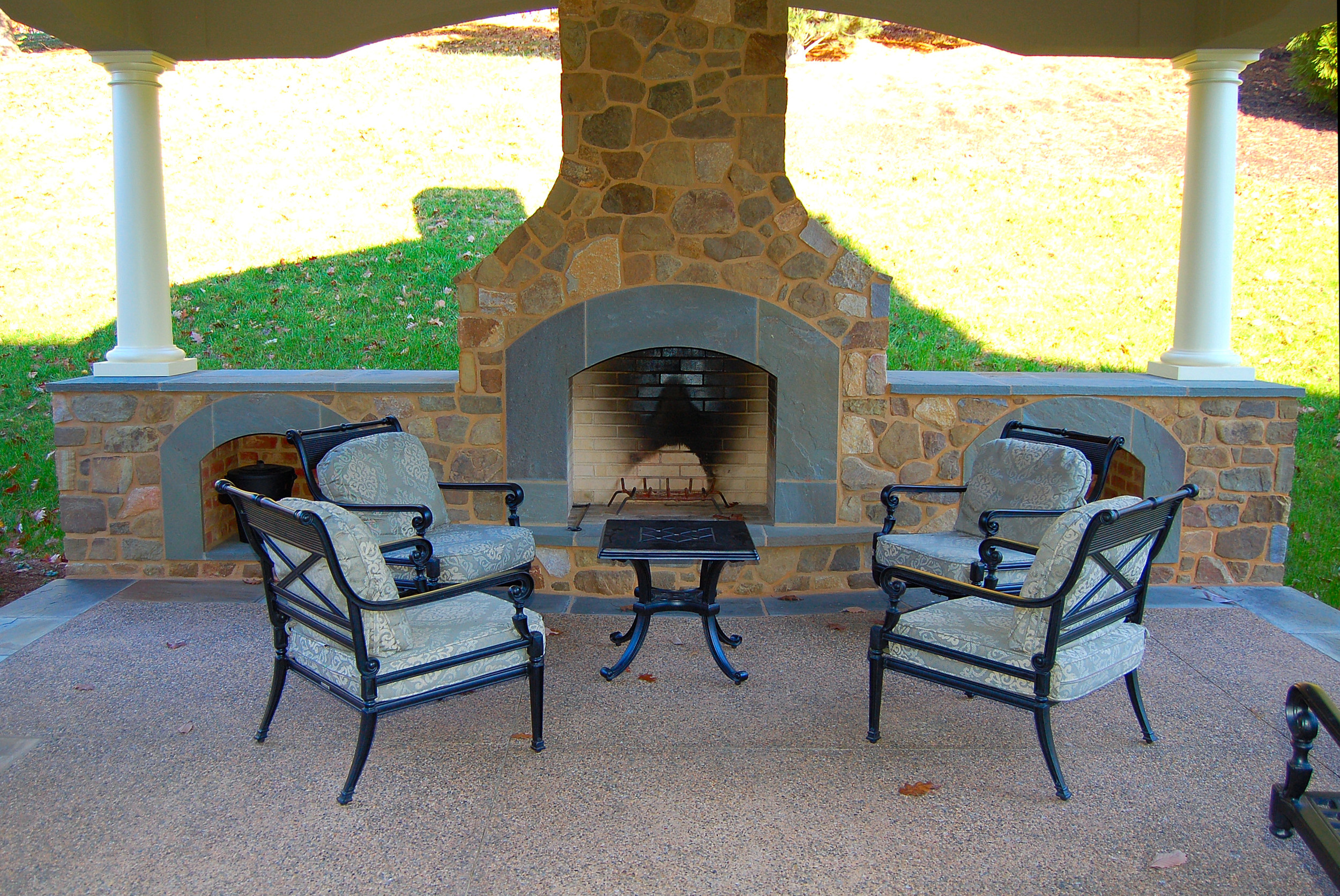 outdoor fireplace with wood storage