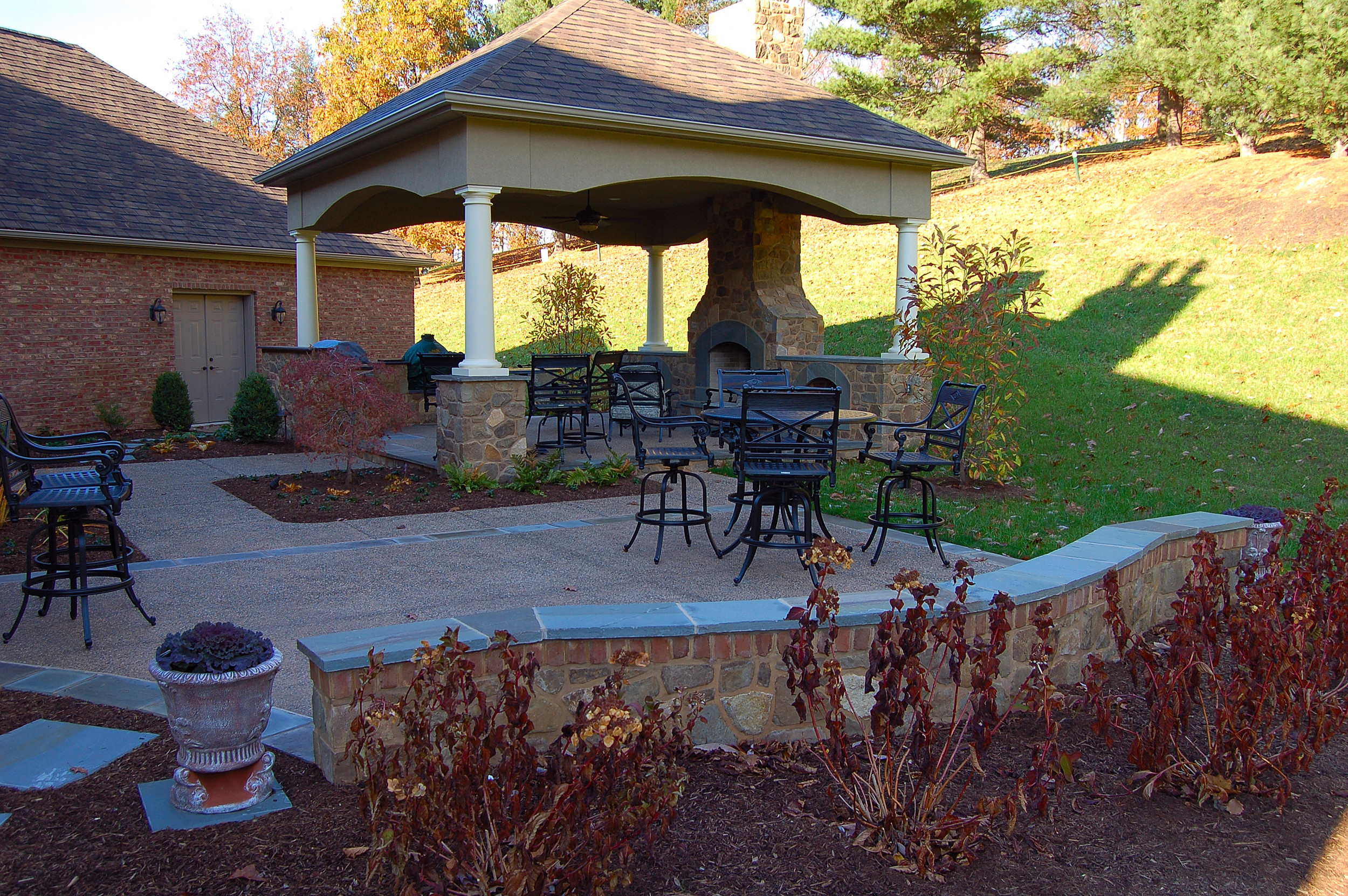 York Pa. residence with a outdoor pavilion, outdoor kitchen and outdoor fireplace. Natural stone walls and patios.