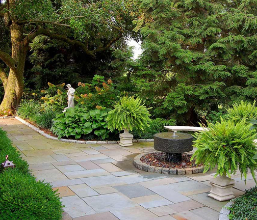 Residential Garden Design with Bluestone Walkway and Contemporary Fountain