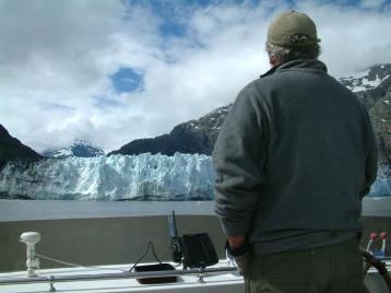 John at the flybridge helm of the Phalaropein upper Glacier Bay.