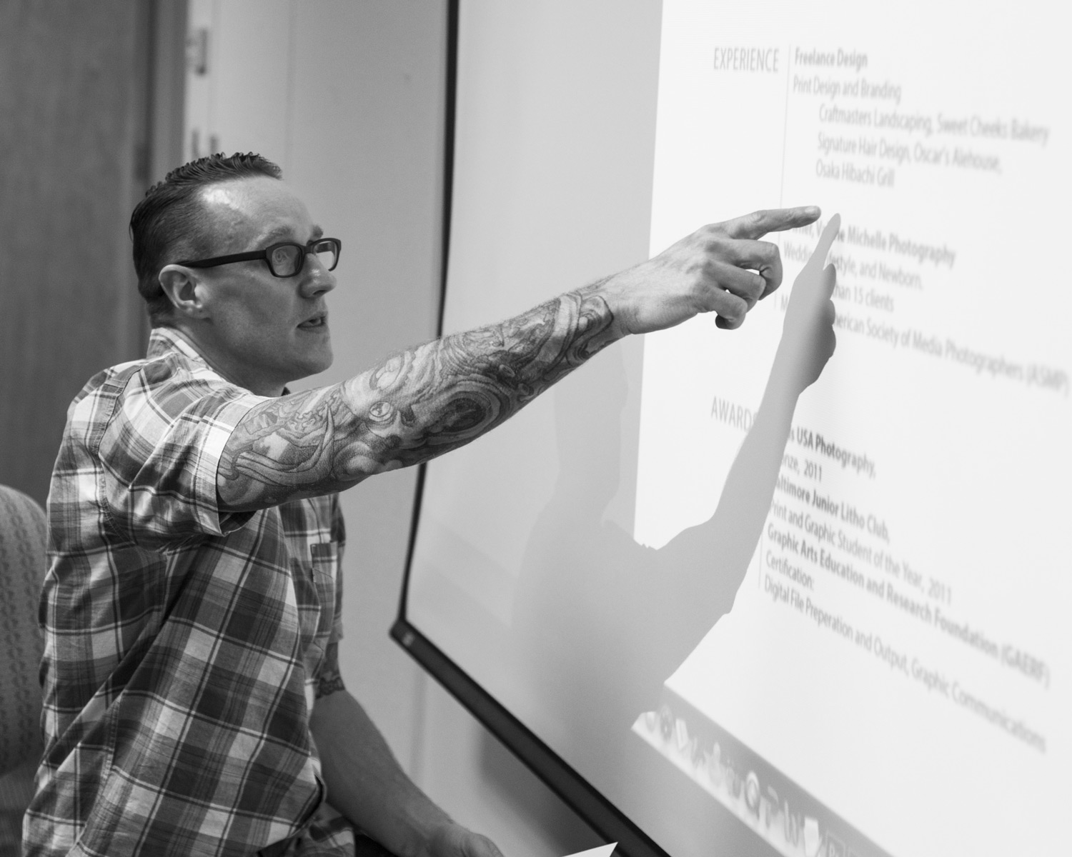 Graphic designer Bob Gillespie reviews a student resume at Stevenson University April 8.