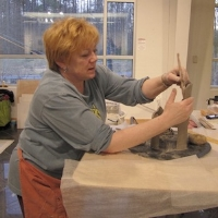 Diana Manchak  has been working in clay since 1989. A long career in the travel industry, combined with her lifelong interest in Art, Art History, Archeology and Design has provided a foundation from which to view and perceive other cultures. Living in Africa and traveling the world has made a lasting artistic impression. These influences - foreign cultures, ancient arts, contemporary design and the natural environment - or elements of them can be found in her work. She began teaching Ceramics in 1995 to young neighborhood kids, and individual students in her studio, and a few years later began teaching classes for children and adults at a community center, including homeschool students. She has taught classes at both CSMD and at the University of Maryland Arts and Learning Center, private students when time permits and makes work for galleries, shows and exhibitions.