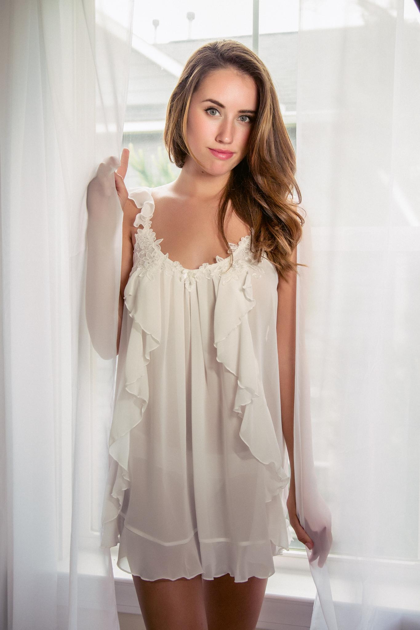 Gorgeous white bridal lingerie boudoir shoot by Boudoir by Marie in Charleston, SC.