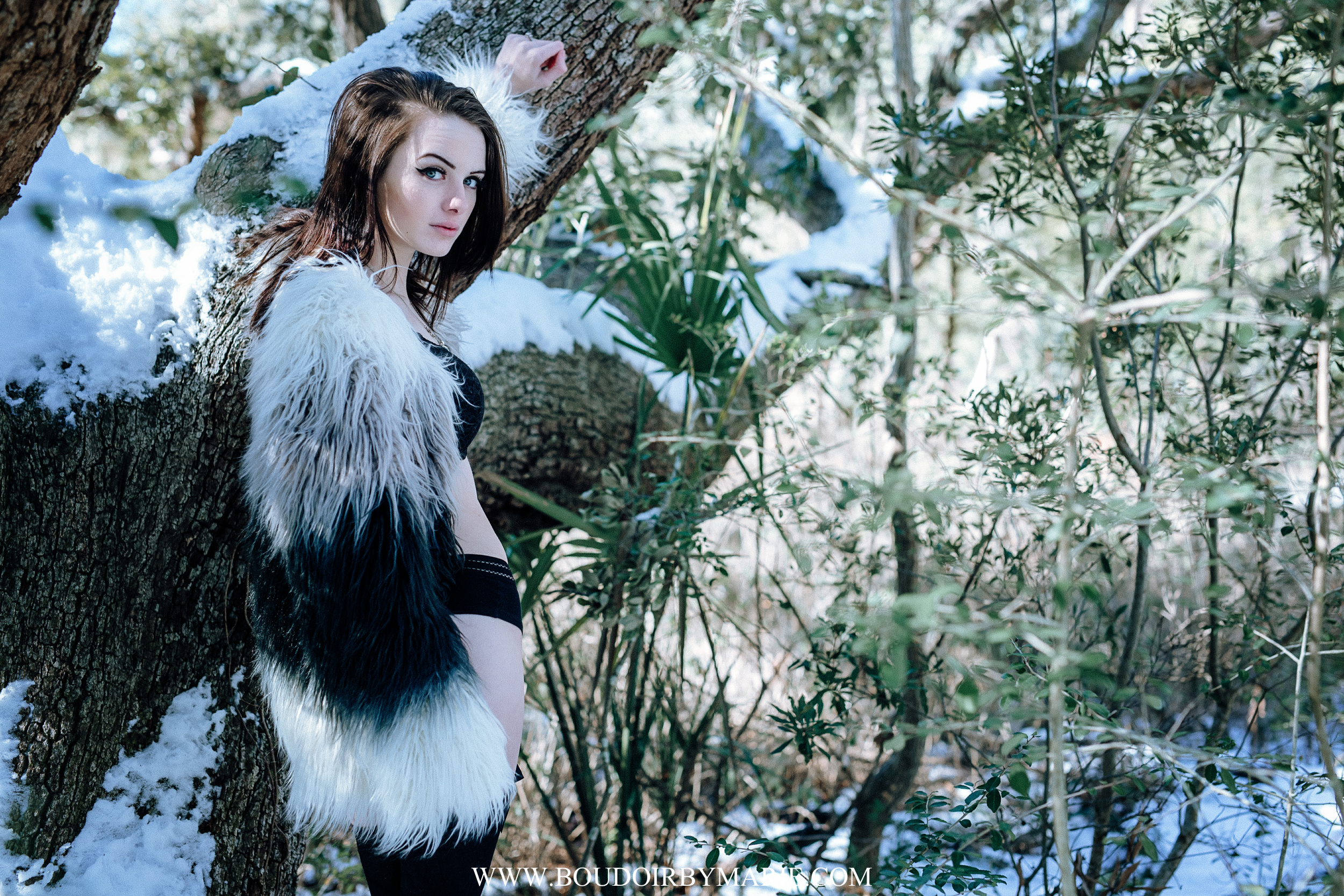 Brunette in high fashion faux fur coat photographed in the boudoir style outside in snow in Charleston, South Carolina.
