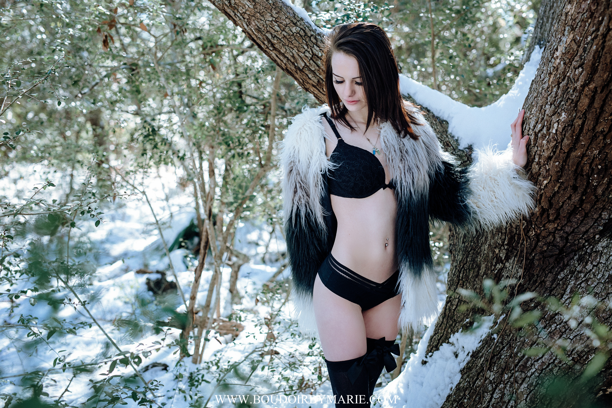 Beautiful winter boudoir photoshoot located outdoors during the South Carolina snowstorm in Charleston.