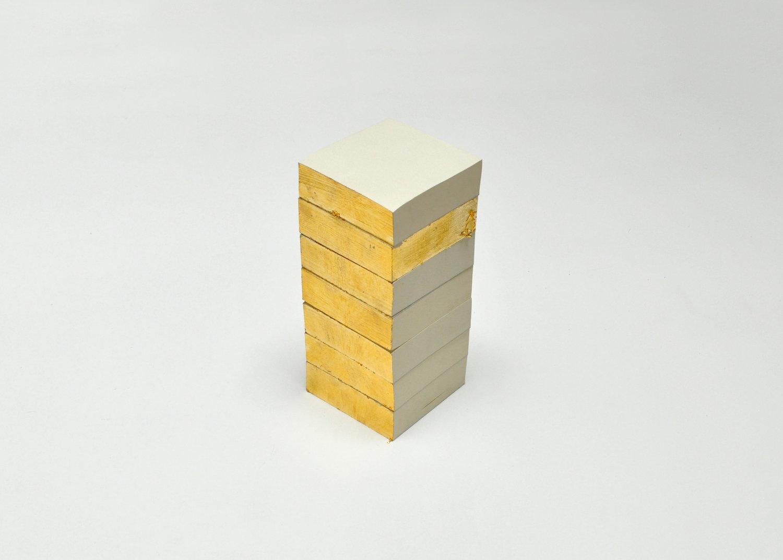 Tower  (2016), Copper-Zinc on paper pads, 10 x 10 x 28 cm