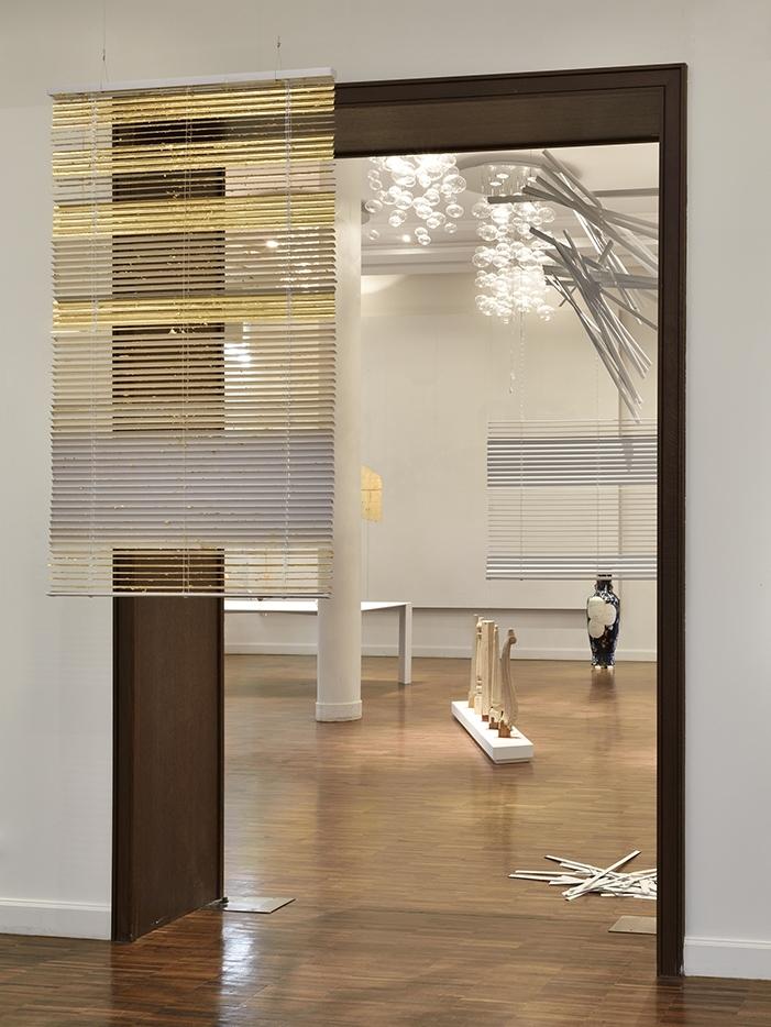 installation view,  Une inconnue d'avance , 2016   ©  Rebecca Fanuele      —    Golden Window, vinyl blind, copper-zinc leaf, 2016  Blind 3/2, vinyl blind, 2015-16