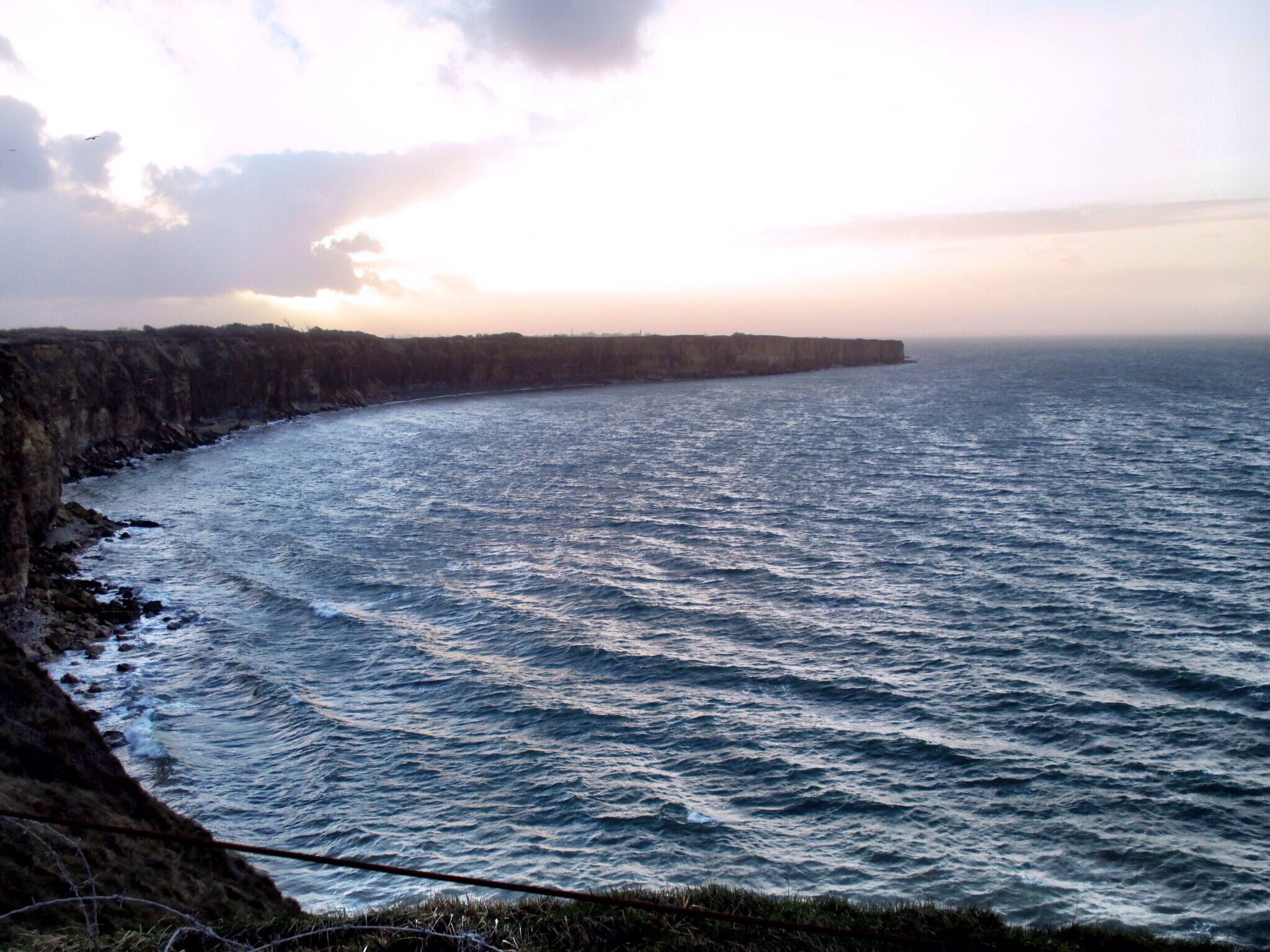 View west from Pointe-du-Hoc and the sheer cliff faces