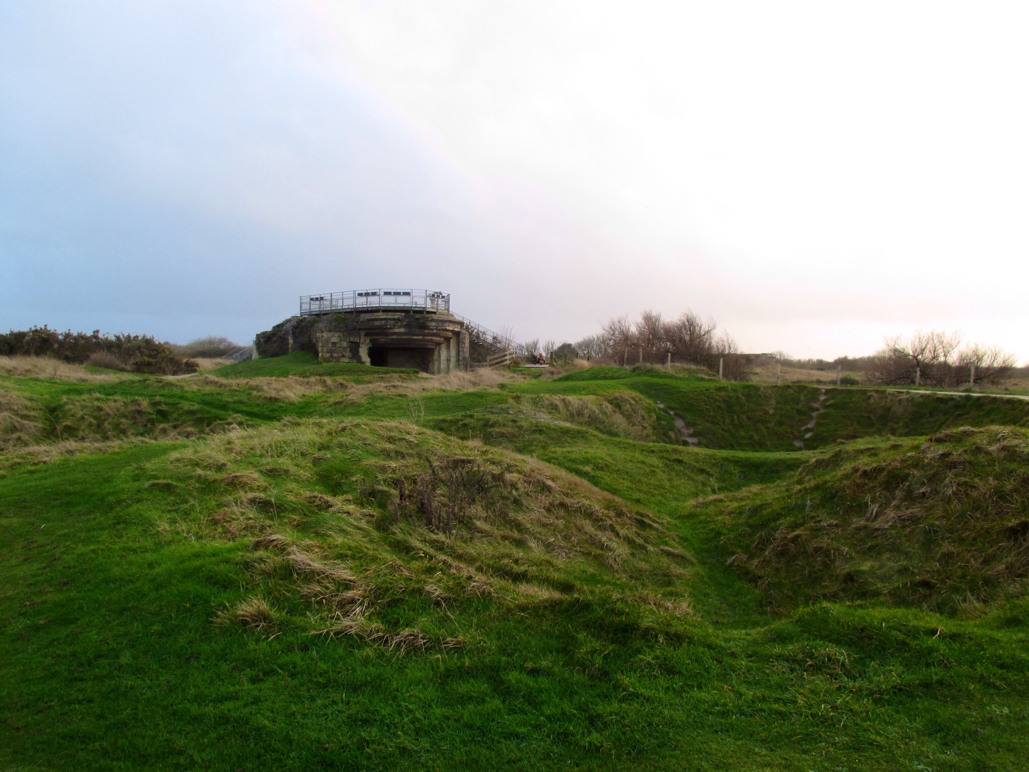 Bomb craters and gun emplacement at Pointe-du-Hoc