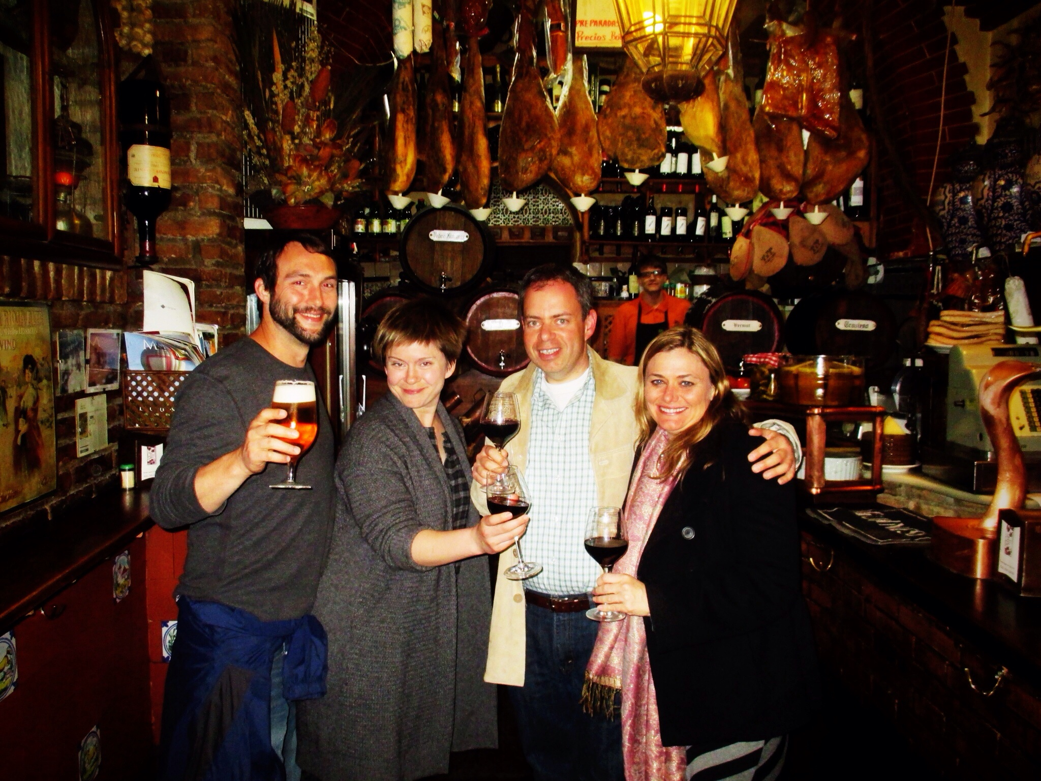 Toasting with our new friends at the last tapas bar of the night in Granada