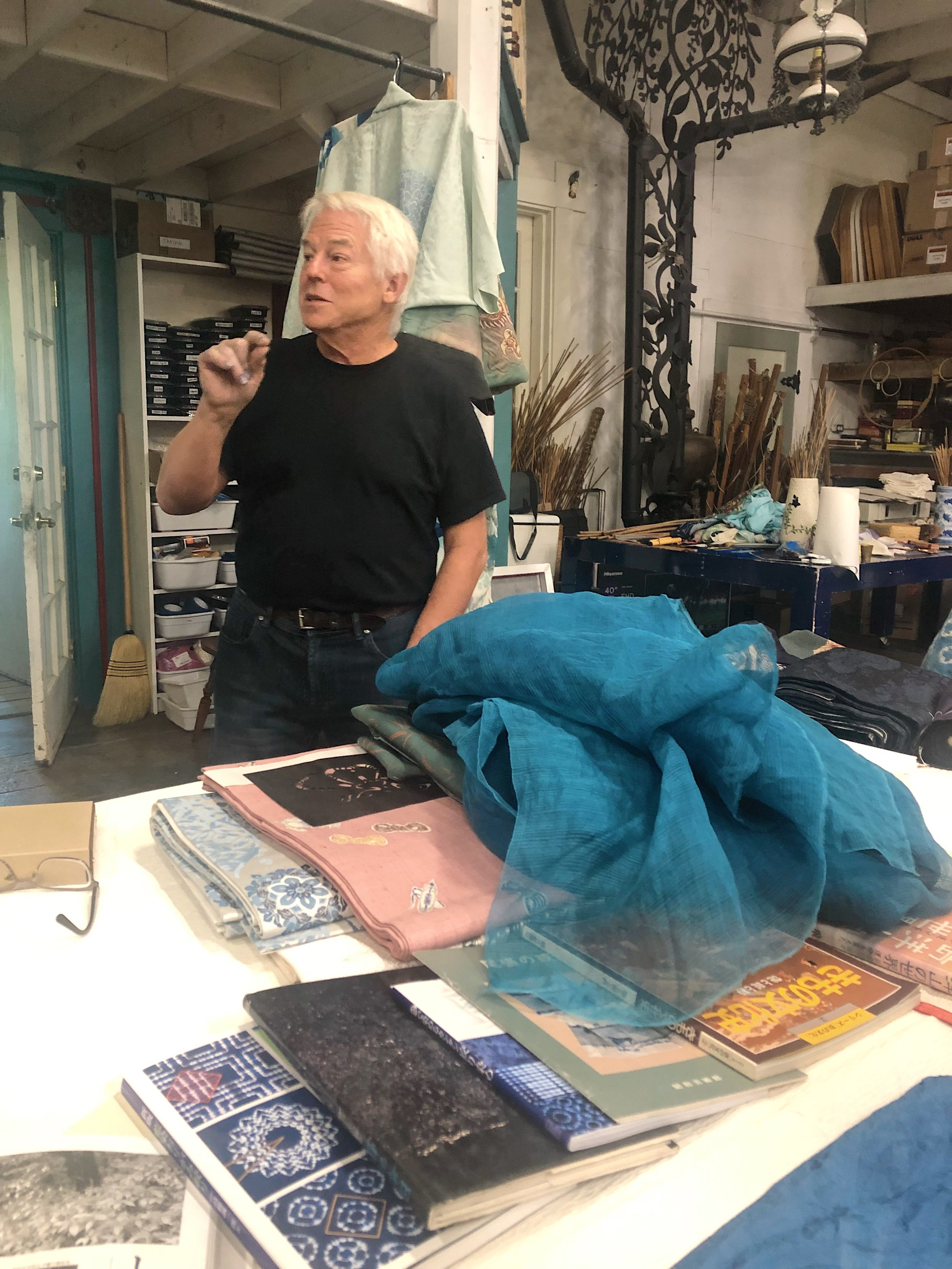 John Marshall in his studio with a cloud of fresh leaf dyed silk