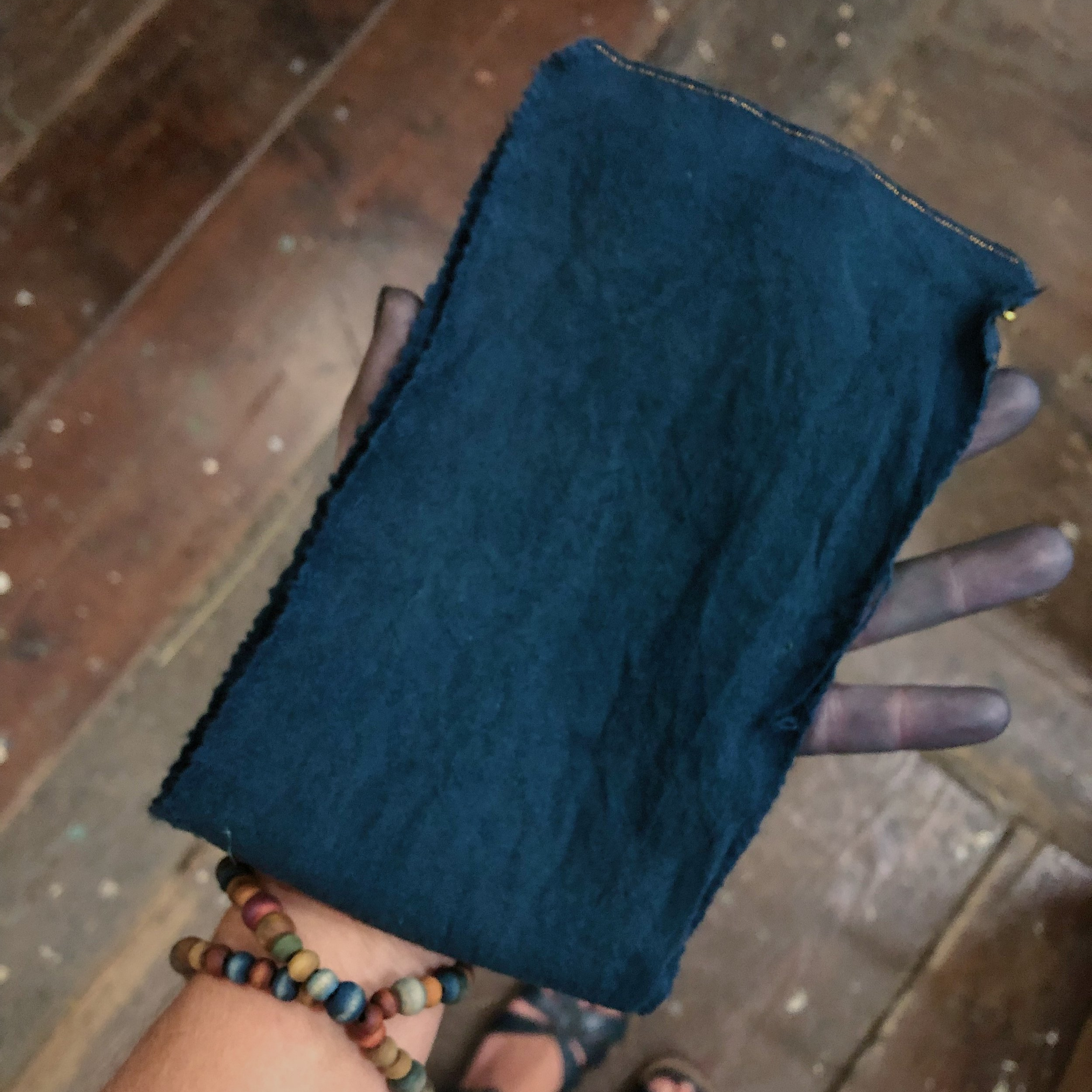 after 5 salt rub fresh indigo sessions, a final rinse & dry, the wool is a dark blue navy color