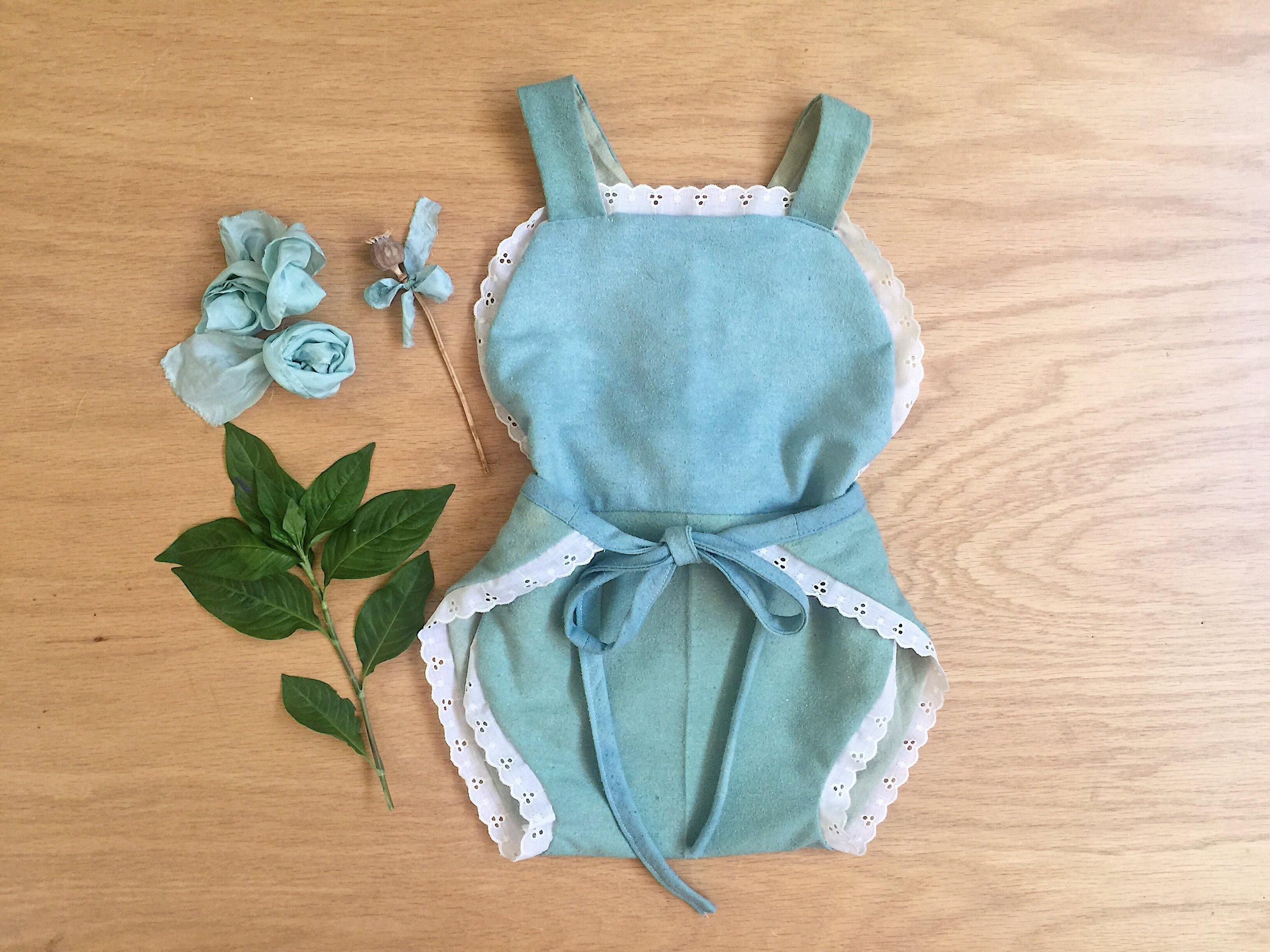 fresh leaf indigo dyed raw silk and vat dyed linen hand sewn romper for my daughter
