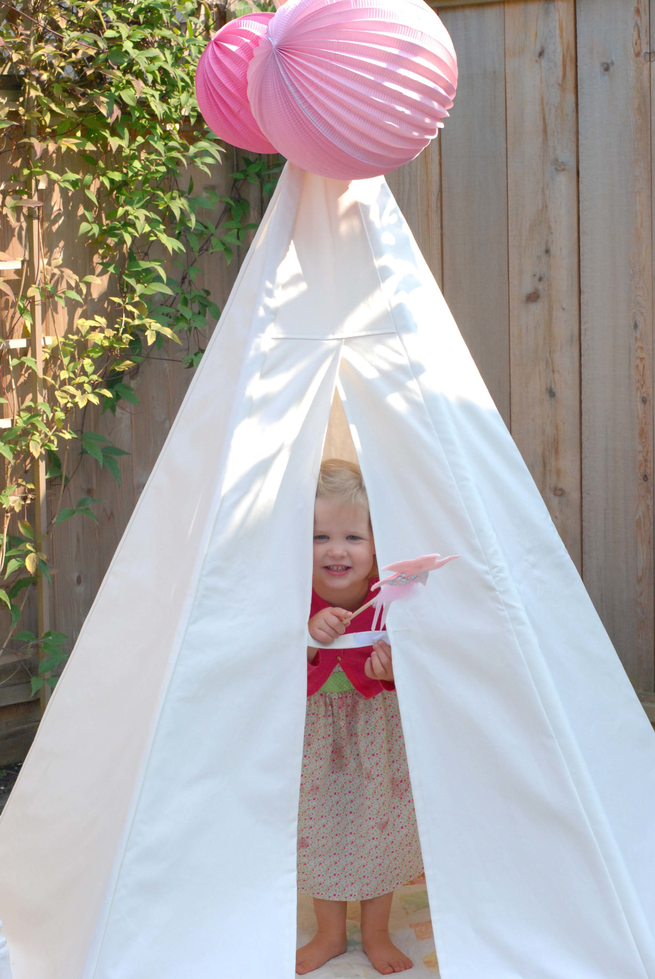peeking out of teepee