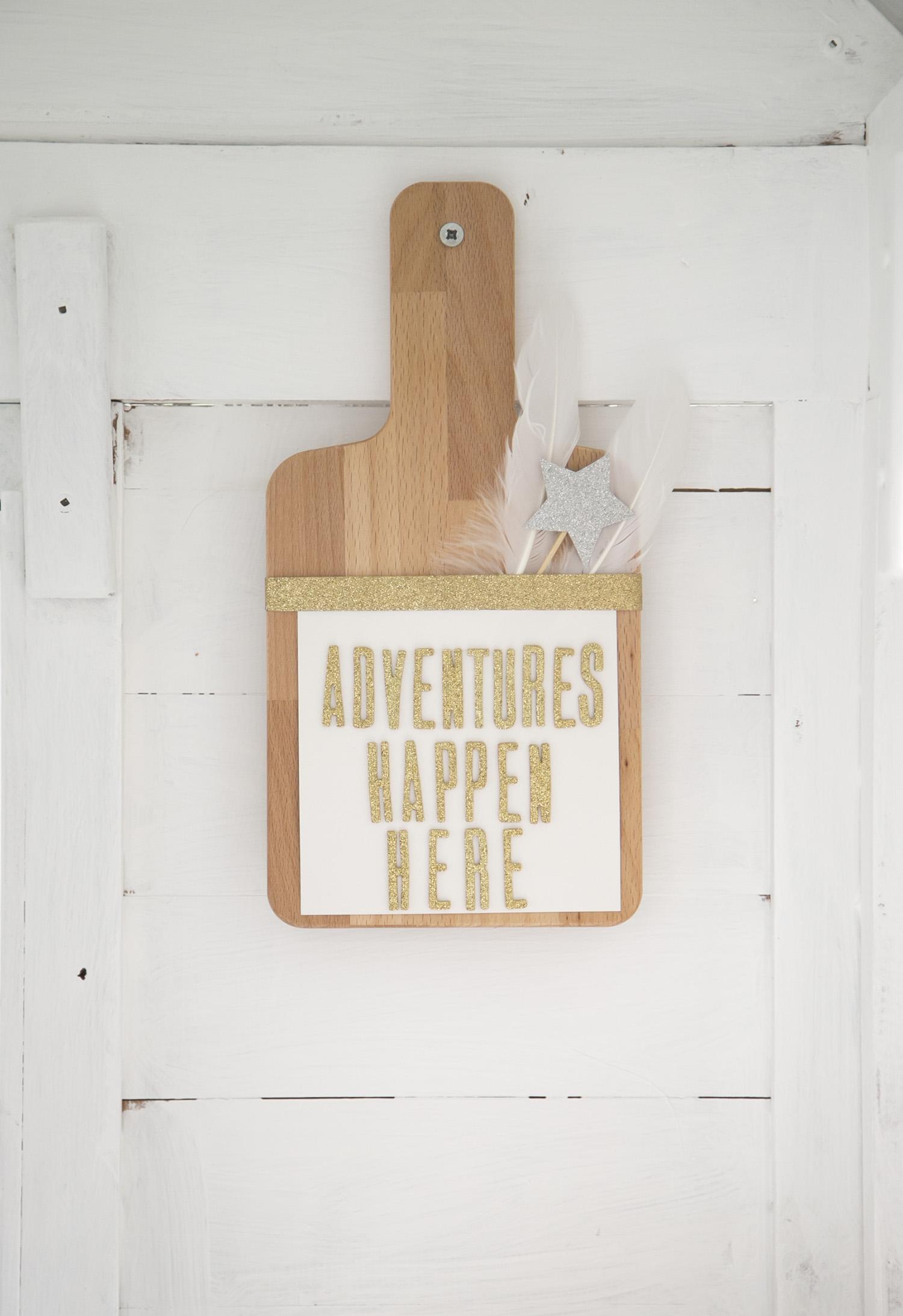 """""""adventures happen here"""" sign"""