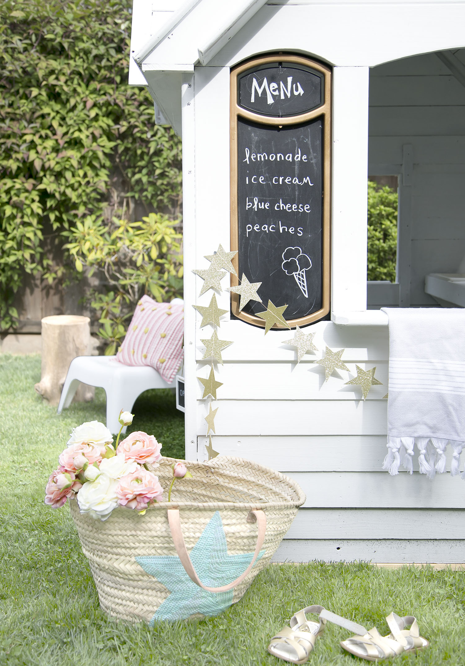 chalkboard menu and market basket with kids playhouse