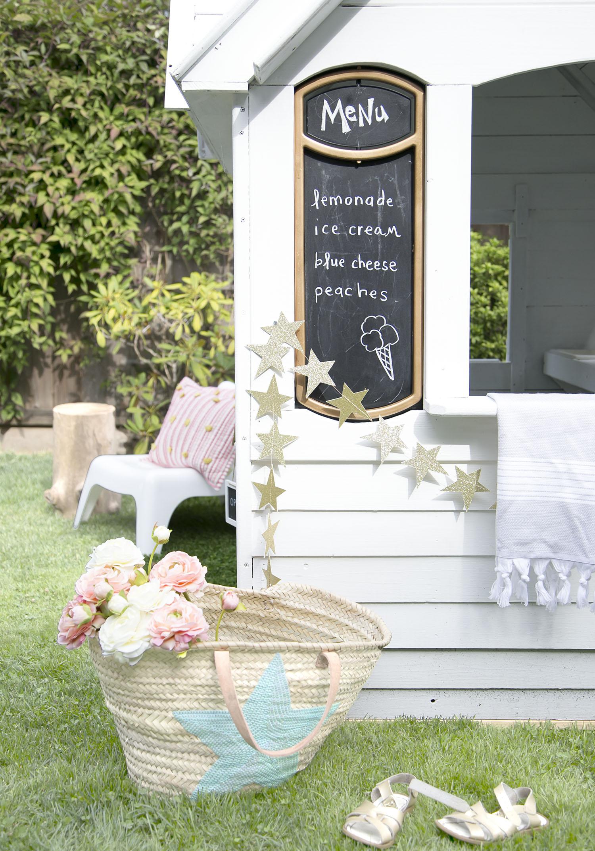 chalkboard menu and market basket with kids playhouse
