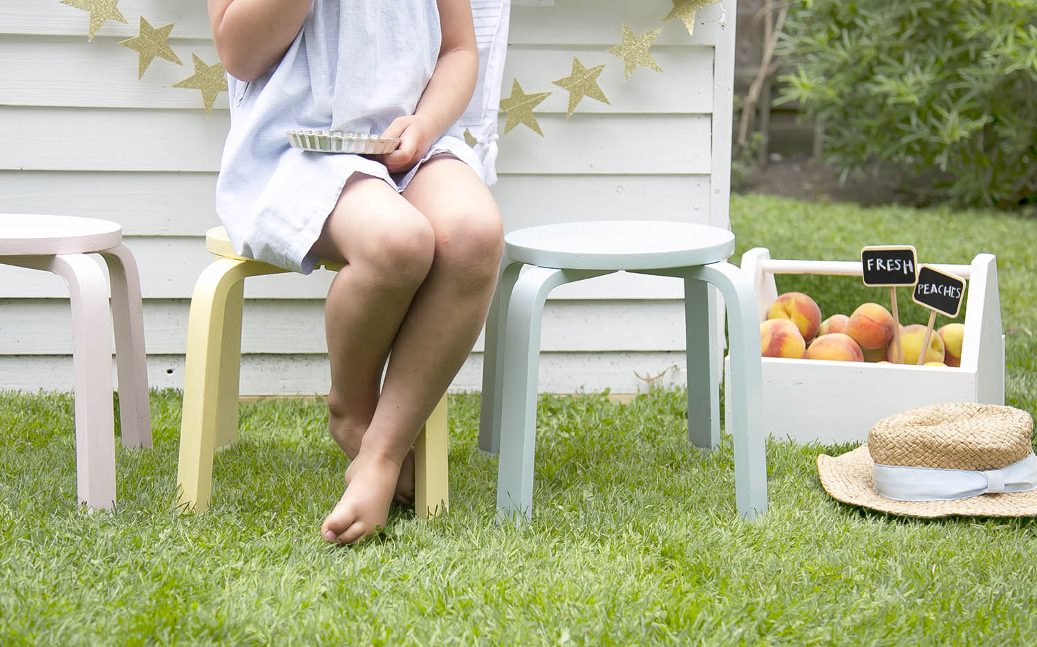 pastel stools and fresh peaches