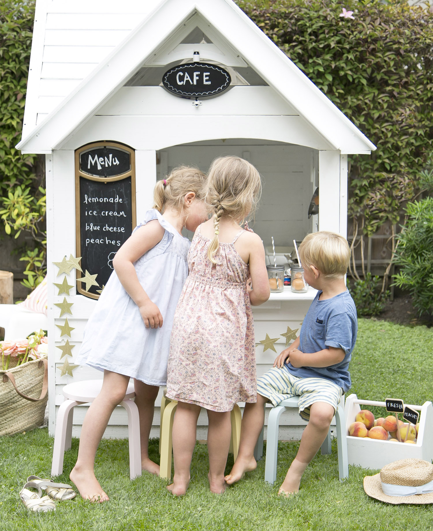 kids playing with outdoor playhouse