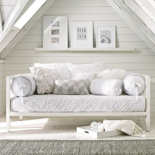 white daybed in loft