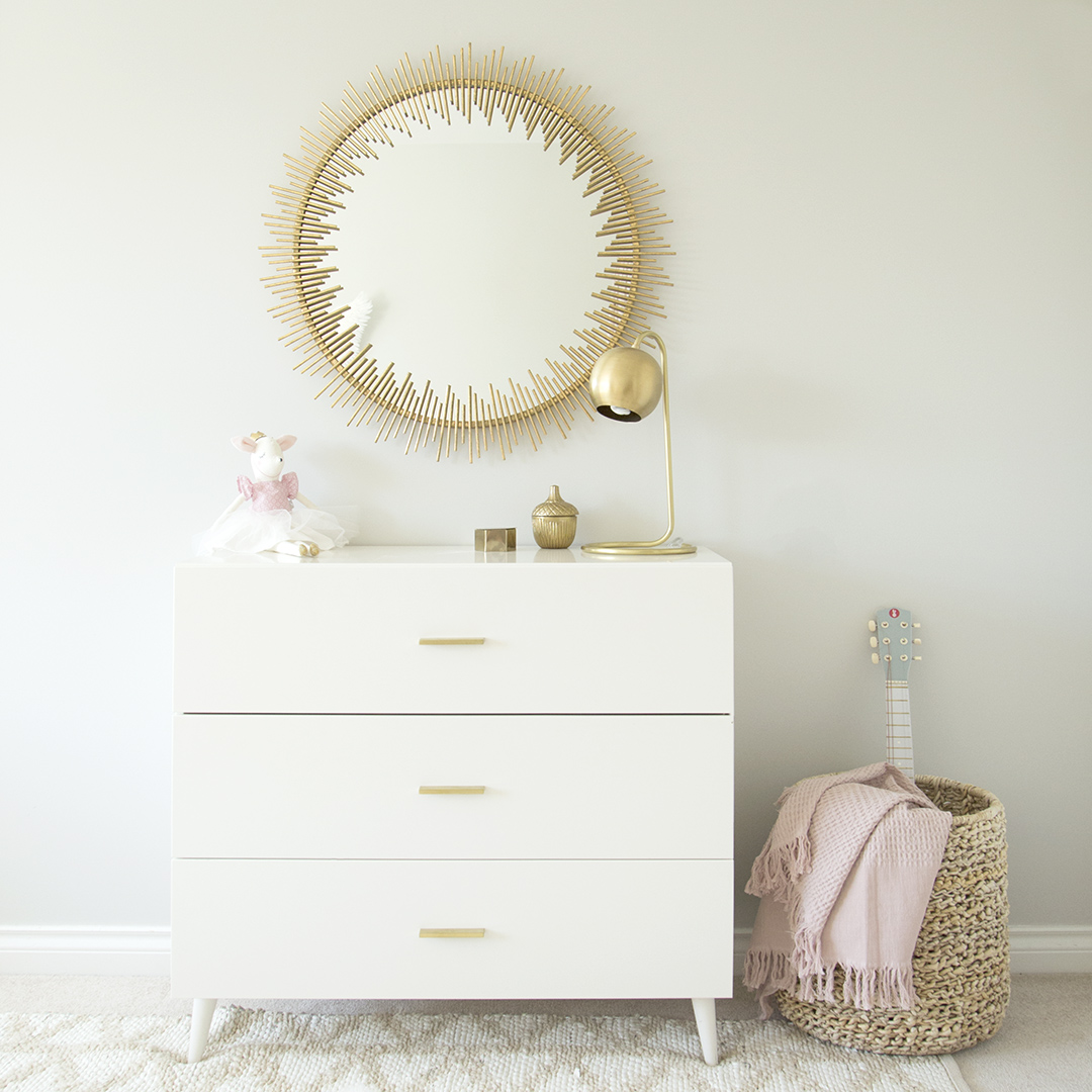 Girls room with gold mirror