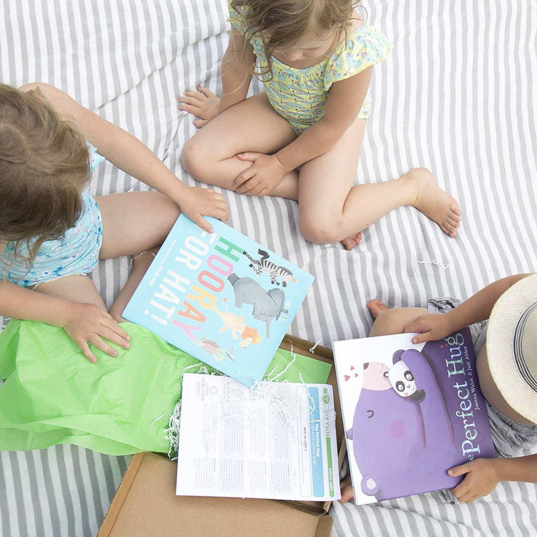 kids opening books from the story box