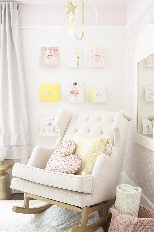 Ubabub book wall in baby girl nursery