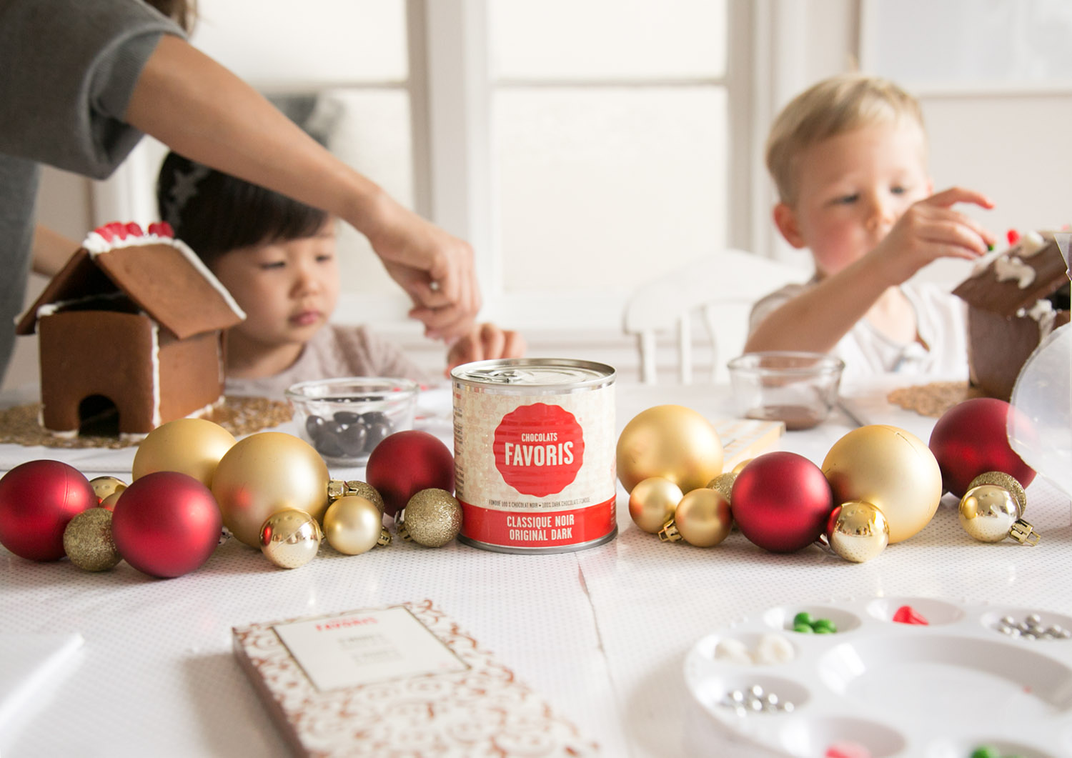 dark fondue by chocolats favoris with kids decorating gingerbread houses