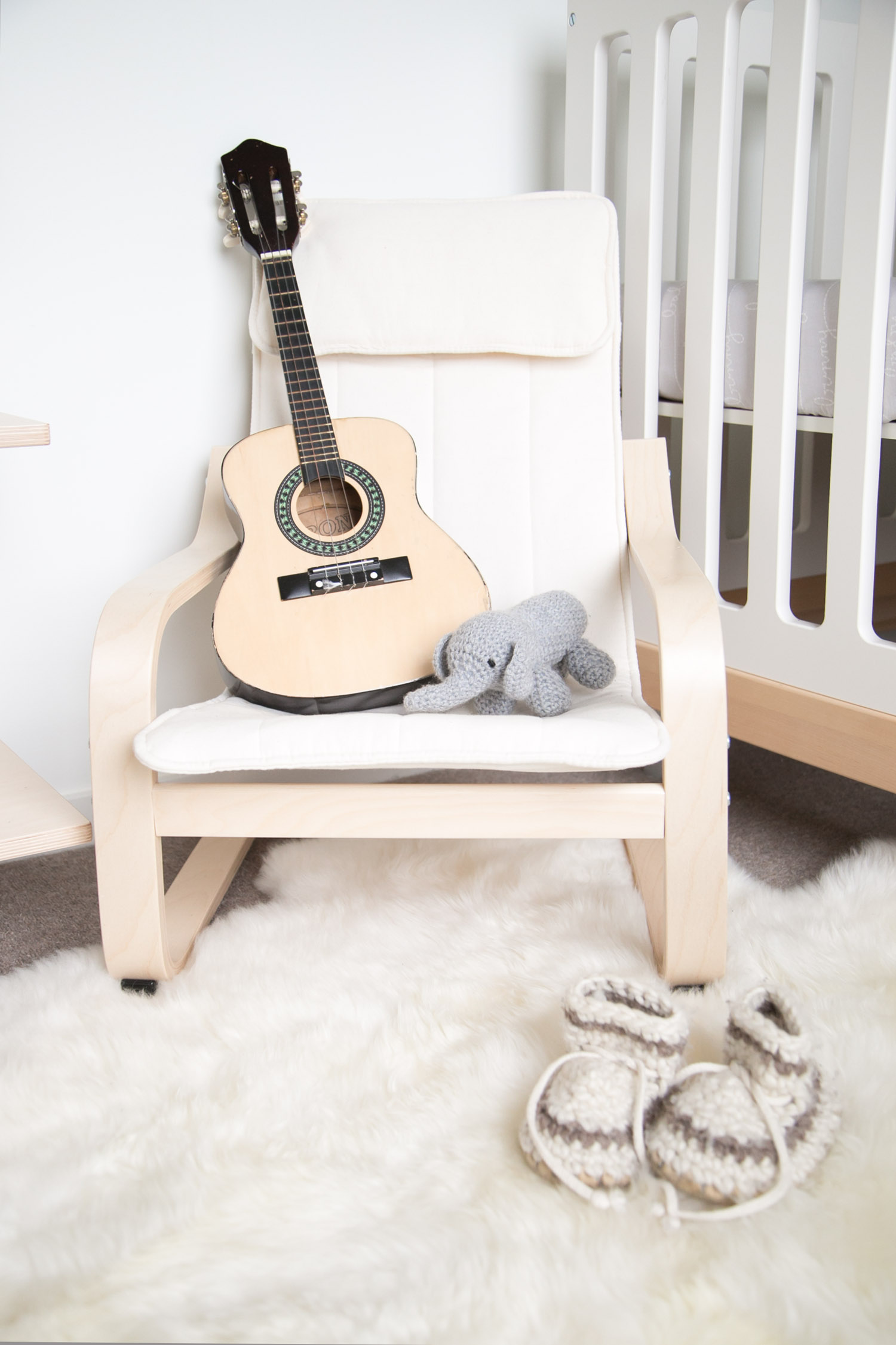 Mini IKEA chair with guitar in kids room