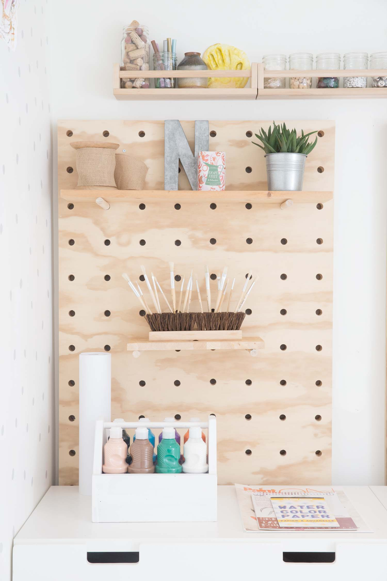 DIY giant pegboard for kids art studio in vancouver, canada
