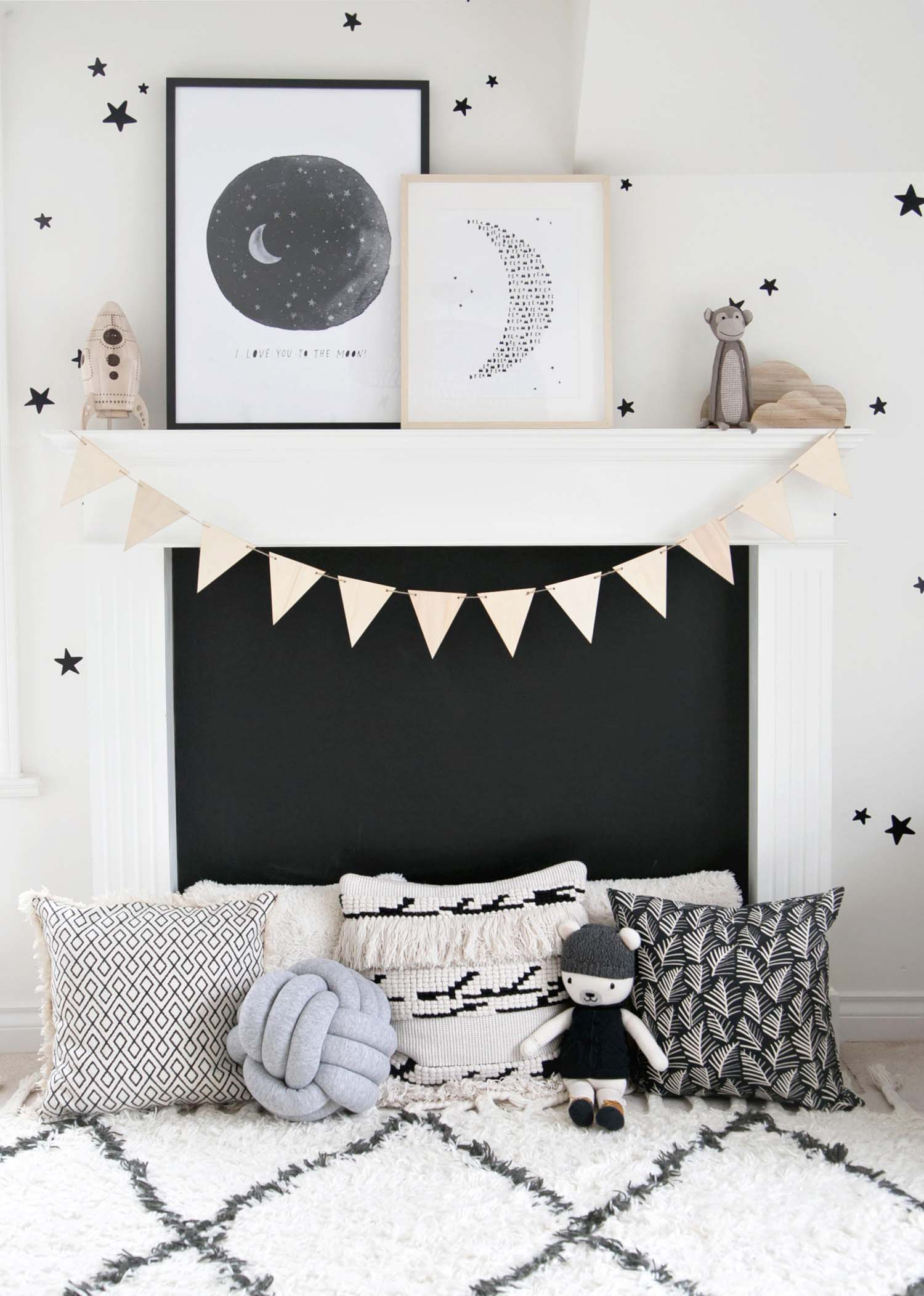 Chalkboard fireplace with art, garland and pillows
