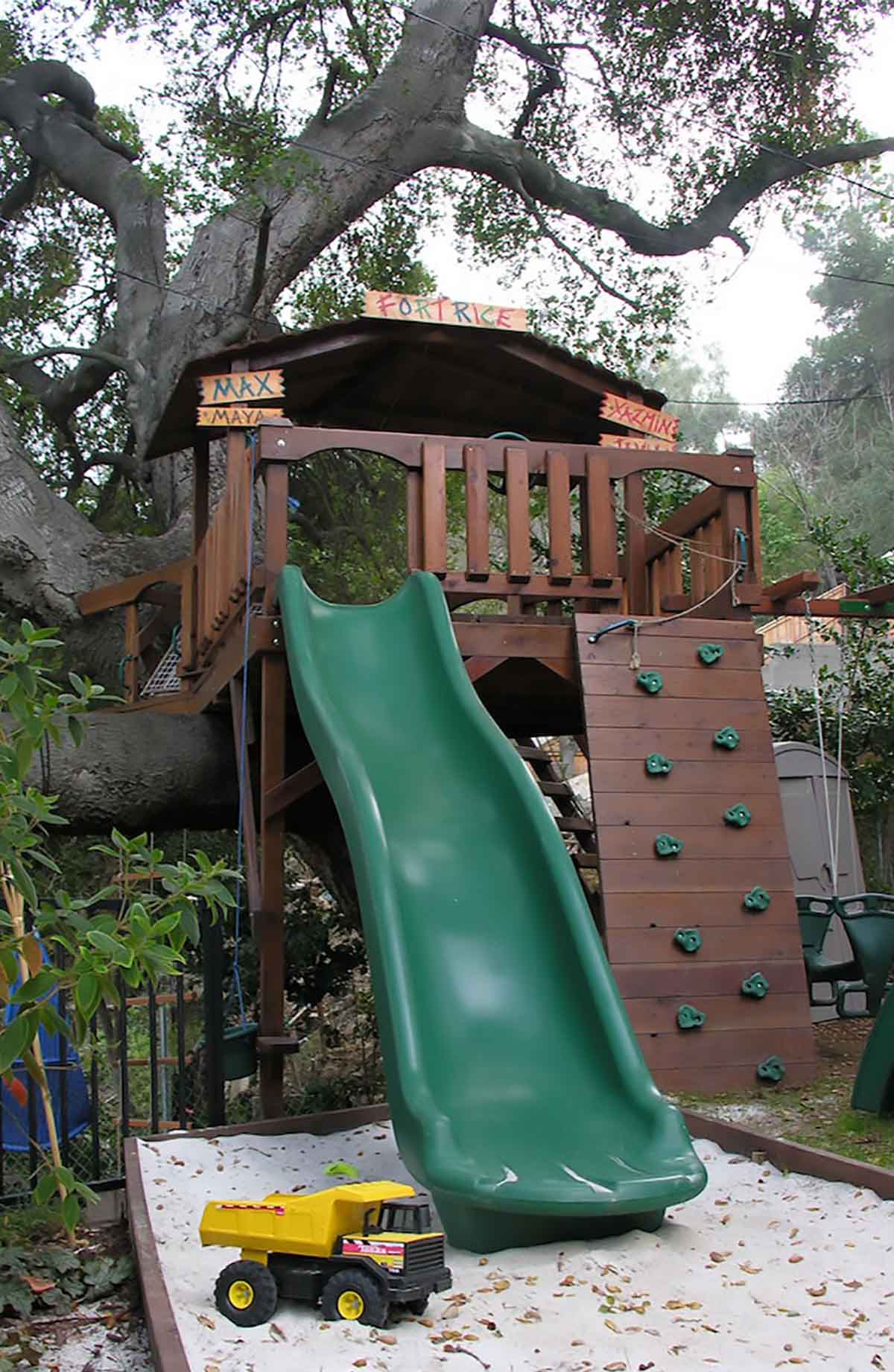 Backyard fort with kids slide