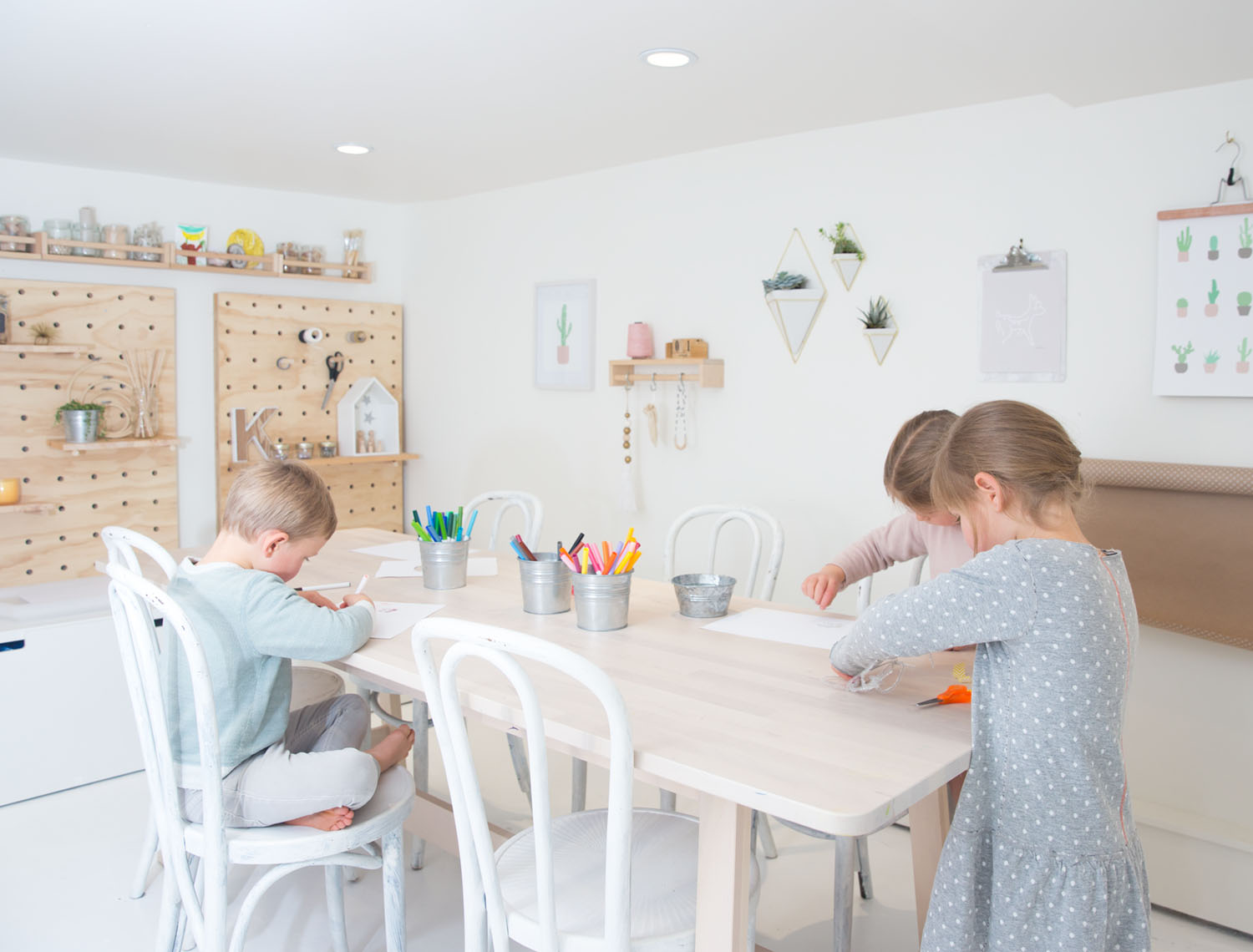 kids home art studio with DIY giant pegboard