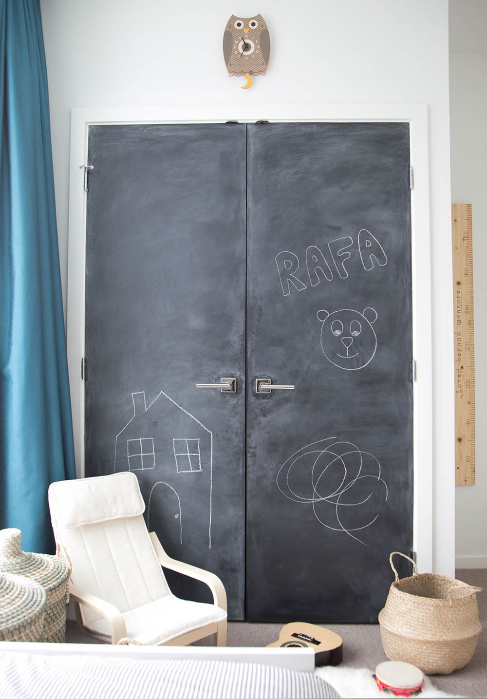 chalkboard closet doors in shared boys room in vancouver, canada