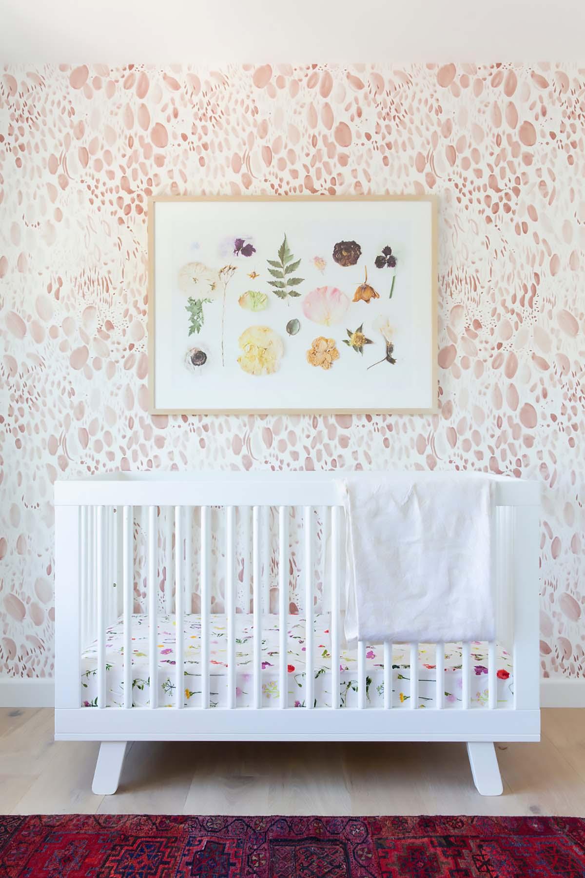 pressed flower art above crib in baby nursery
